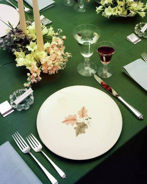 Alcoholic Drink Photograph - A Table Setting On A Green Tablecloth by Haanel Cassidy