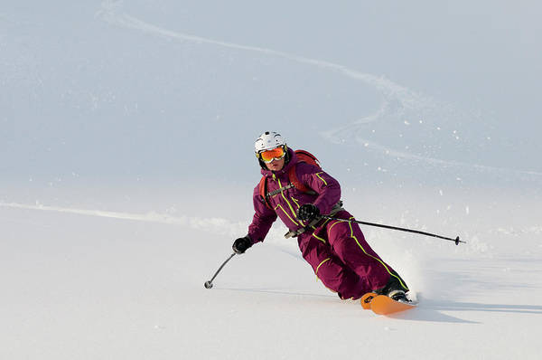 Ski Tracks Wall Art - Photograph - A Telemark Skier Skis Down  Lissje by Kari Medig
