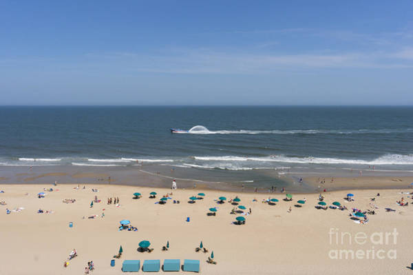 A Touring Speedboat Passes By Shore In Ocean City Maryland Art Print