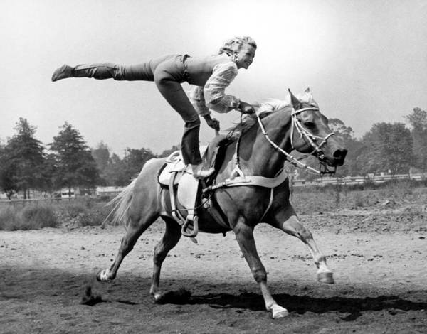 Stunt Photograph - A Trickriding Cowgirl by Underwood Archives