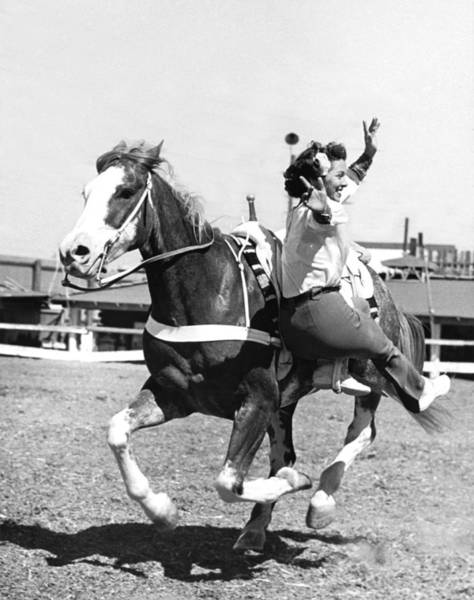 1947 Photograph - A Trickriding Cowgirl by Underwood Archives