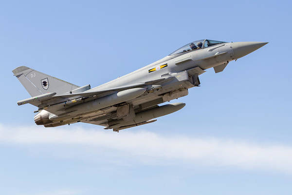 Flying The Flag Wall Art - Photograph - A Typhoon Of The Royal Air Force Climbs by Rob Edgcumbe