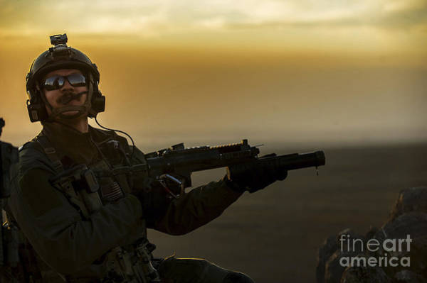 Grenade Launcher Wall Art - Photograph - A U.s. Air Force Pararescueman Provides by Stocktrek Images