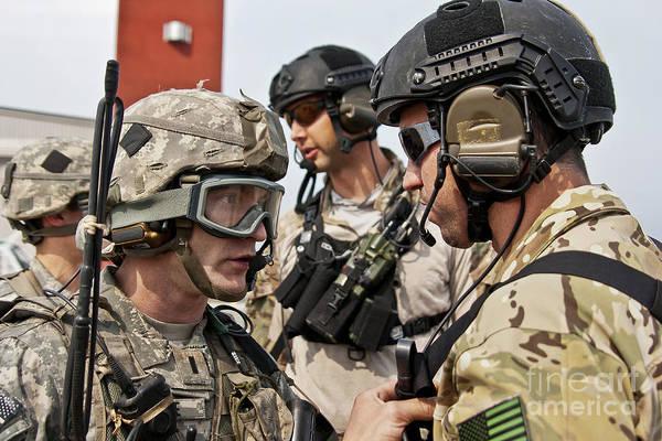 Elmendorf Photograph - A U.s. Army Paratrooper Coordinates An by Stocktrek Images