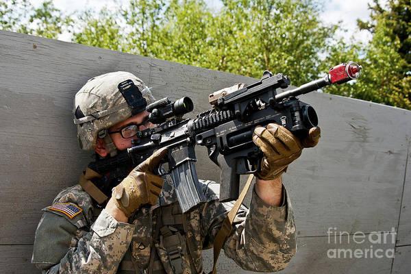 Elmendorf Photograph - A U.s. Army Paratrooper Provides by Stocktrek Images