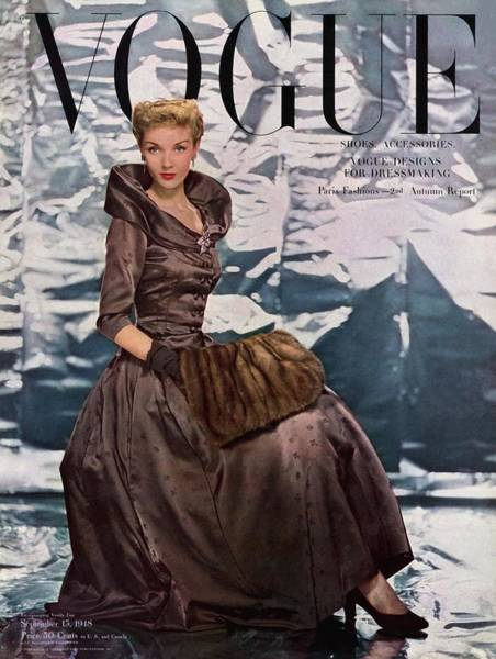 Old People Photograph - A Vogue Cover Of A Woman Wearing A Brown Dress by Erwin Blumenfeld