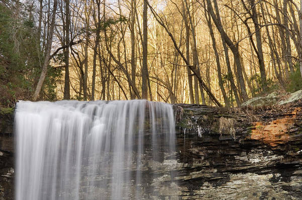 Cloudland Canyon Photograph - A Waterfall Drops Over A Cliff by Andrew Kornylak