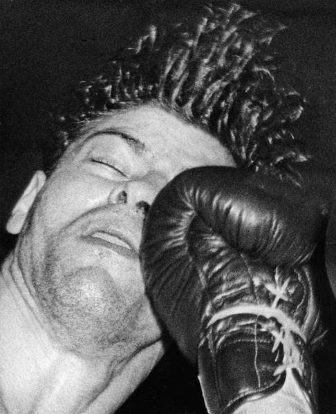 Joey Photograph - A Welterweight Uppercut by Underwood Archives
