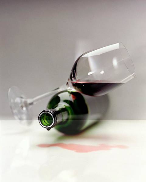 Copy Photograph - A Wine Bottle And A Glass Of Wine by Romulo Yanes
