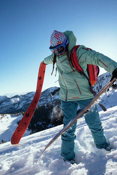 Knit Hat Photograph - A Woman Backcountry Skiing by Mike Schirf