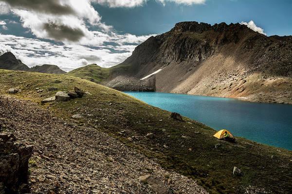 Wall Art - Photograph - A Woman Camping Near A  Blue Lake, San by Kennan Harvey