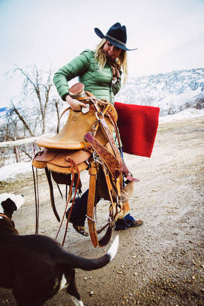 Wall Art - Photograph - A Woman Carries Her Saddle Back by Mike Schirf
