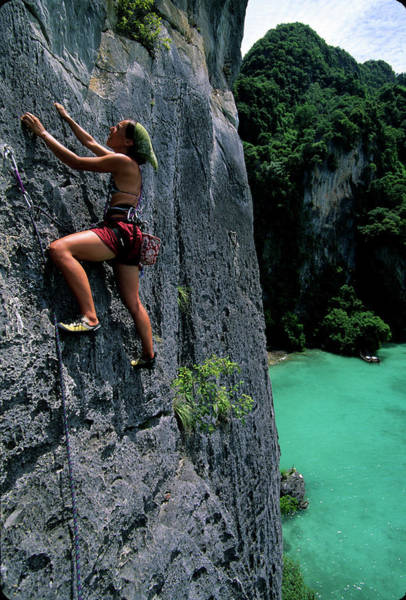 Wall Art - Photograph - A Woman Climbs Above The Ocean by Bennett Barthelemy