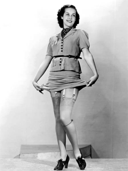 Garter Photograph - A Woman Displays Her Garters by Underwood Archives