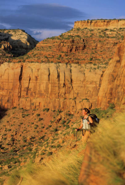 Wall Art - Photograph - A Woman Hikes Along The Base Of A Wall by Rich Wheater