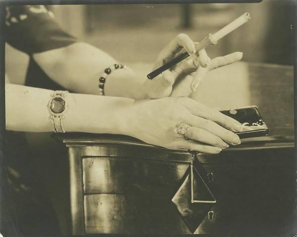 Body Part Photograph - A Woman Holding A Cigarette Holder by Edward Steichen