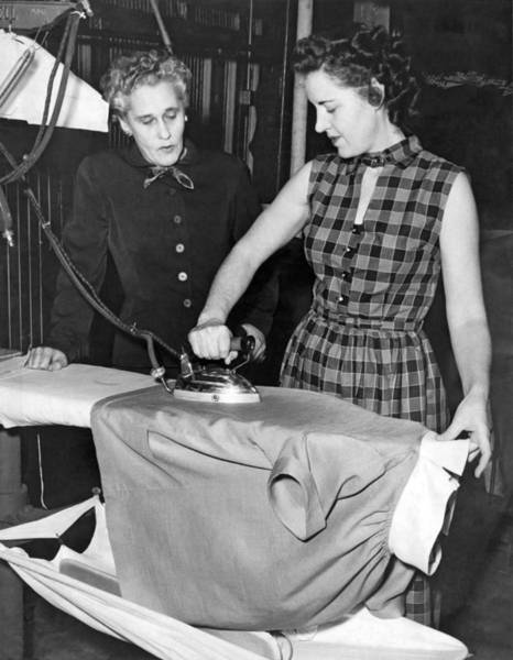 In Law Photograph - A Woman Irons A Shirt by Underwood Archives