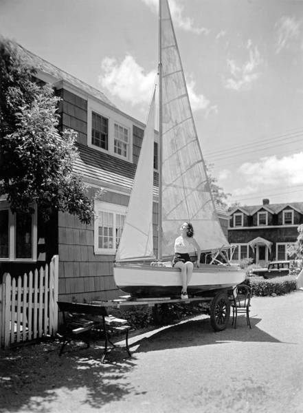 Sunbather Photograph - A Woman On Sailboat At Home by Underwood Archives