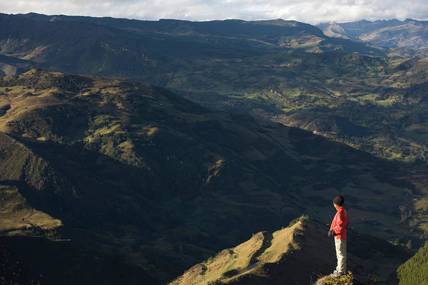 Boyaca Photograph - A Woman Overlooks A Range Of Mountains by Dennis Drenner