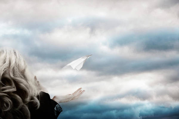 Released Photograph - A Woman Releasing A Paper Plane Into by Andrew Bret Wallis