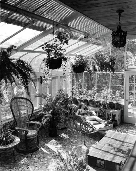 Photograph - A Woman Resting On A Chair Inside A Greenhouse by Eric J. Baker