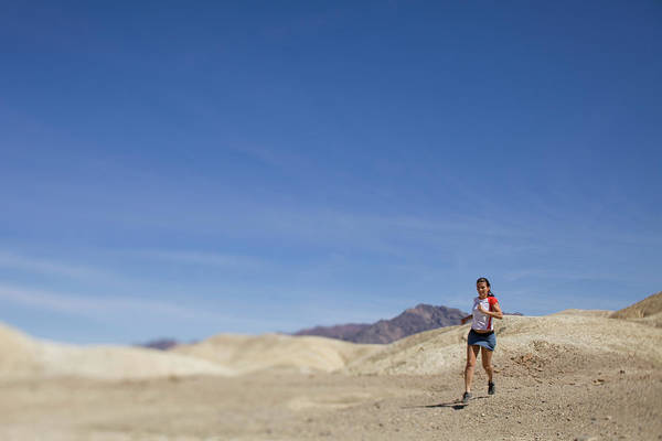 Wall Art - Photograph - A Woman Running In The Desert by Woods Wheatcroft