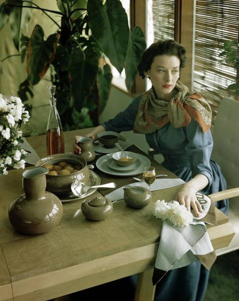 Dine Photograph - A Woman Sitting At A Dining Table by Horst P. Horst