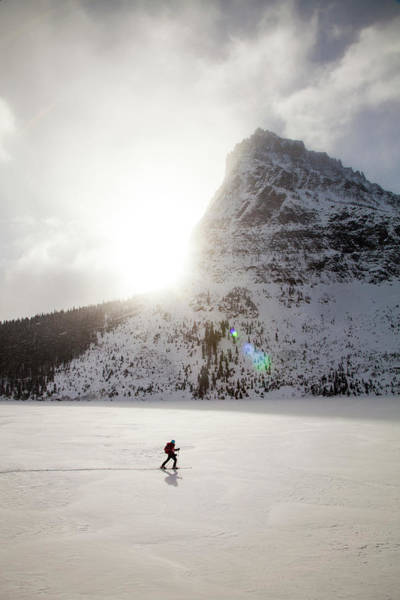 Back In The Day Photograph - A Woman Skiing On Two Medicine Lake by Robin Carleton
