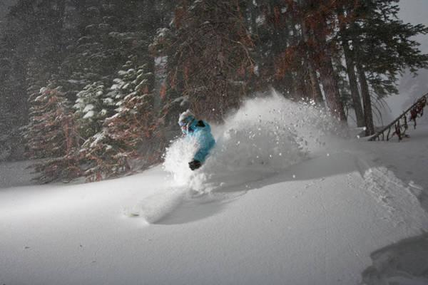 Wall Art - Photograph - A Woman Skis A Powdery Slope At A Ski by Jose Azel