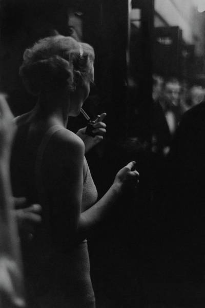 Two People Photograph - A Woman Smoking At The Music Box by Remie Lohse