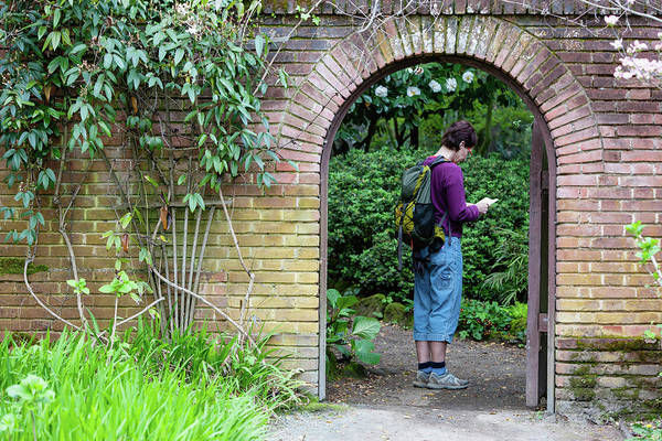 Filoli Photograph - A Woman Standing Under An Archway by Ron Koeberer