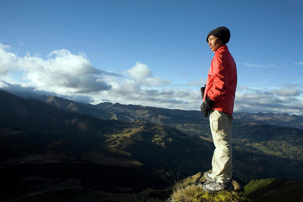 Boyaca Photograph - A Woman Stands On Top Of A Mountain by Dennis Drenner