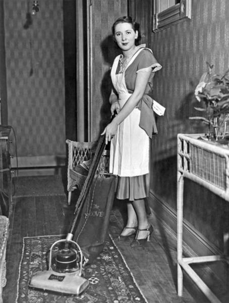 Apron Wall Art - Photograph - A Woman Vacuuming by Underwood Archives