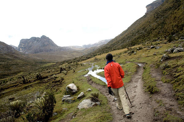 Boyaca Photograph - A Woman Walks Through A Valley In El by Dennis Drenner