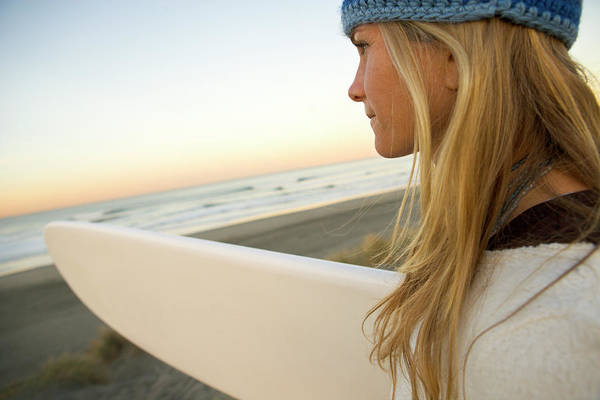 Wall Art - Photograph - A Woman With Surfboard Checks by Ty Milford