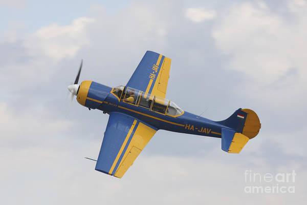 Yakovlev Photograph - A Yakolev Yak-52 Plane Flying by Timm Ziegenthaler