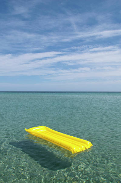 Raft Photograph - A Yellow Inflatable Raft Floating On by Caspar Benson