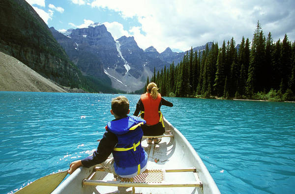 Moraine Lake Photograph - A Young Boy And His Mother Explore by Todd Korol