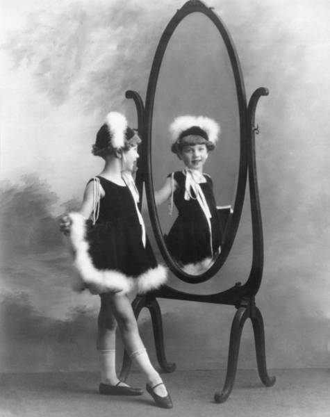 Dressing Up Photograph - A Young Girl In A Mirror by Underwood Archives