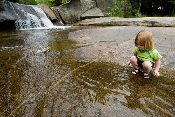 Exuberance Photograph - A Young Girl Plays Near A Waterfall by Nick Lambert