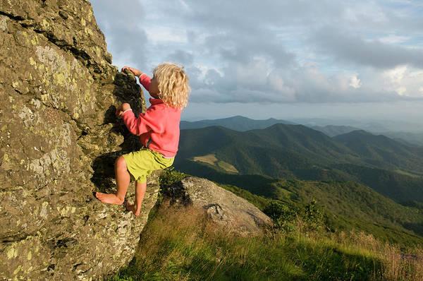 Wall Art - Photograph - A Young Girl Rock Climbing On Grassy by Kennan Harvey