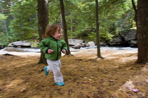 Exuberance Photograph - A Young Girl Runs Through The Woods by Nick Lambert