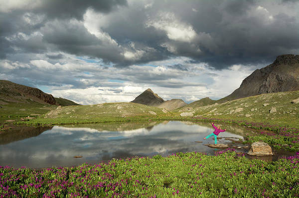 Wall Art - Photograph - A Young Girl Standing Next To Alpine by Kennan Harvey