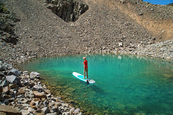 Robbie Photograph - A Young Male Paddleboarding On A Small by Brandon Huttenlocher