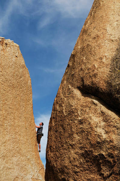 Wall Art - Photograph - A Young, Male Rock Climber Ascends by Kyle George