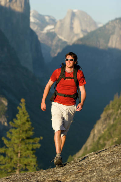 Wall Art - Photograph - A Young Man Backpacking In Yosemite by Justin Bailie