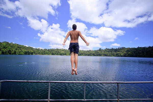 Far North Queensland Wall Art - Photograph - A Young Man Jumps Into The Refreshing by Paul Dymond
