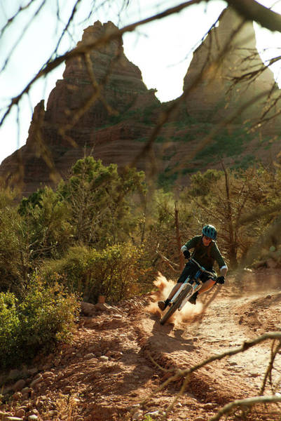 Wall Art - Photograph - A Young Man Rides A Mountain Bike by Jeff Diener