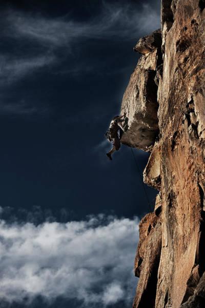Hanging Rock Photograph - A Young Man Rock Climbing Pulls by Patrick Orton