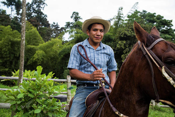 Manizales Photograph - A Young Man Sits On A Horse And Smiles by Modoc Stories